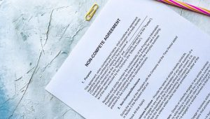 Blank non-compete agreement page on a marble table